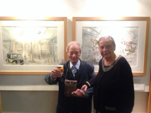 Guy Dessicy and his wife in front of the 2 Bob De Moor drawings.