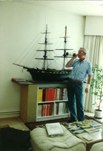 A picture taken of Bob De Moor in front of the model of an English merchant brig from 1850.